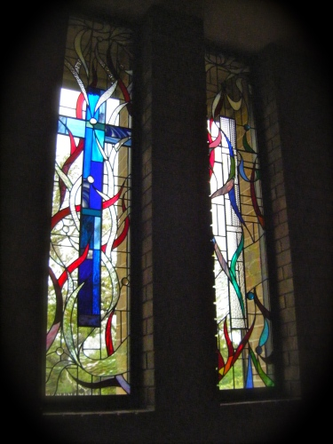 "the last two church windows of the series ""Living God Consuming Fire'"